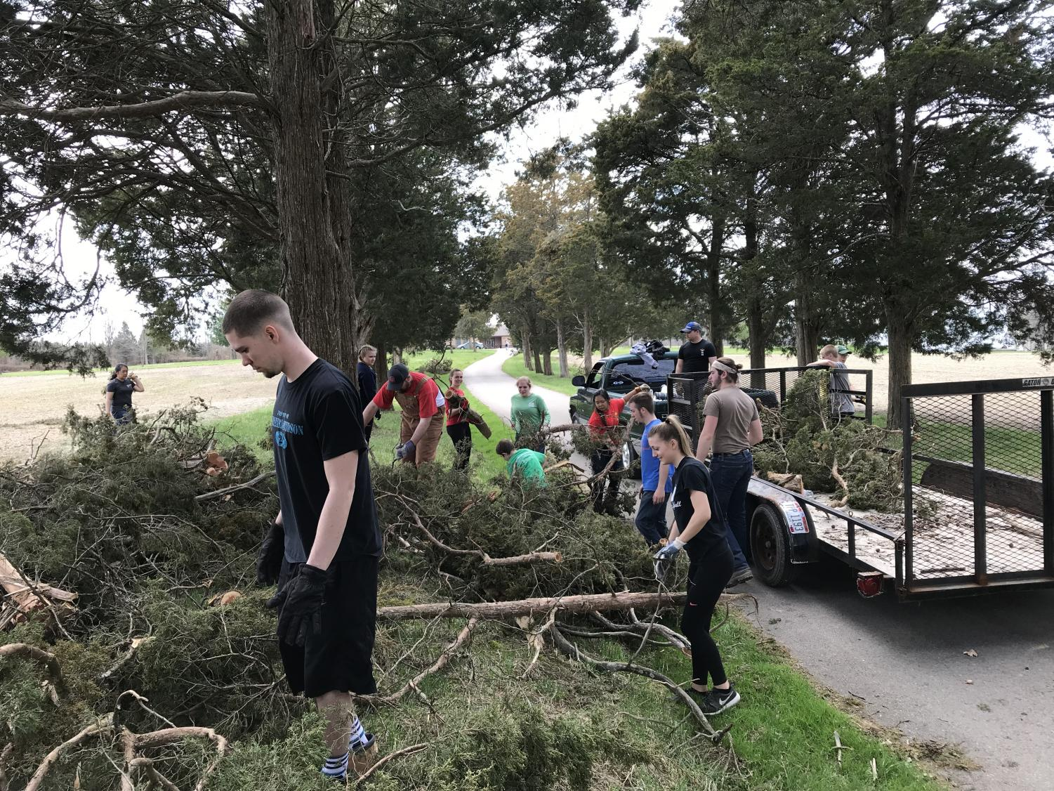 Herd 4 Christ members help clean up fallen trees at Midwestern Children's Home in Pleasant Plain, Ohio.