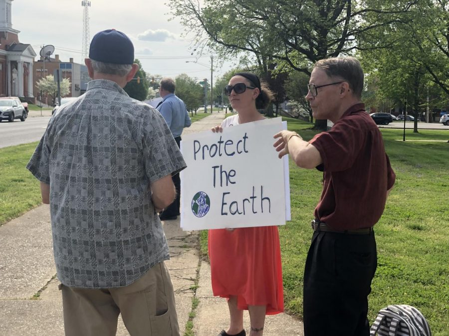 Local+Protect+our+Planet+protestors+take+to+the+streets+with+signs+and+informational+pamphlets.