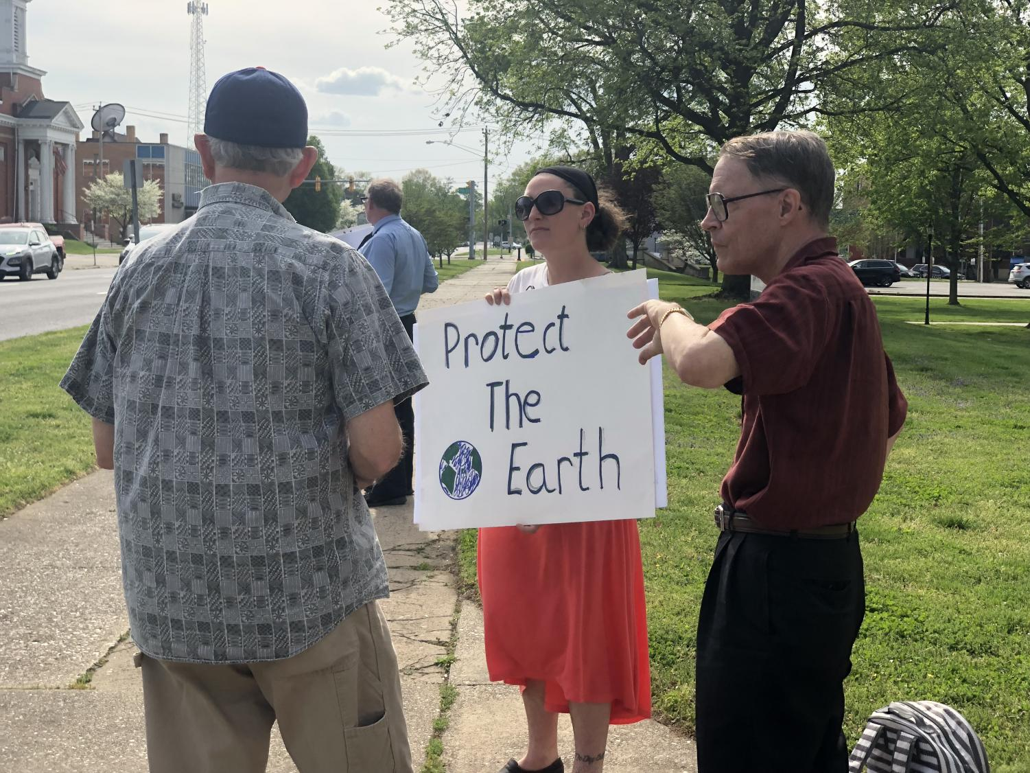 Local Protect our Planet protestors take to the streets with signs and informational pamphlets.