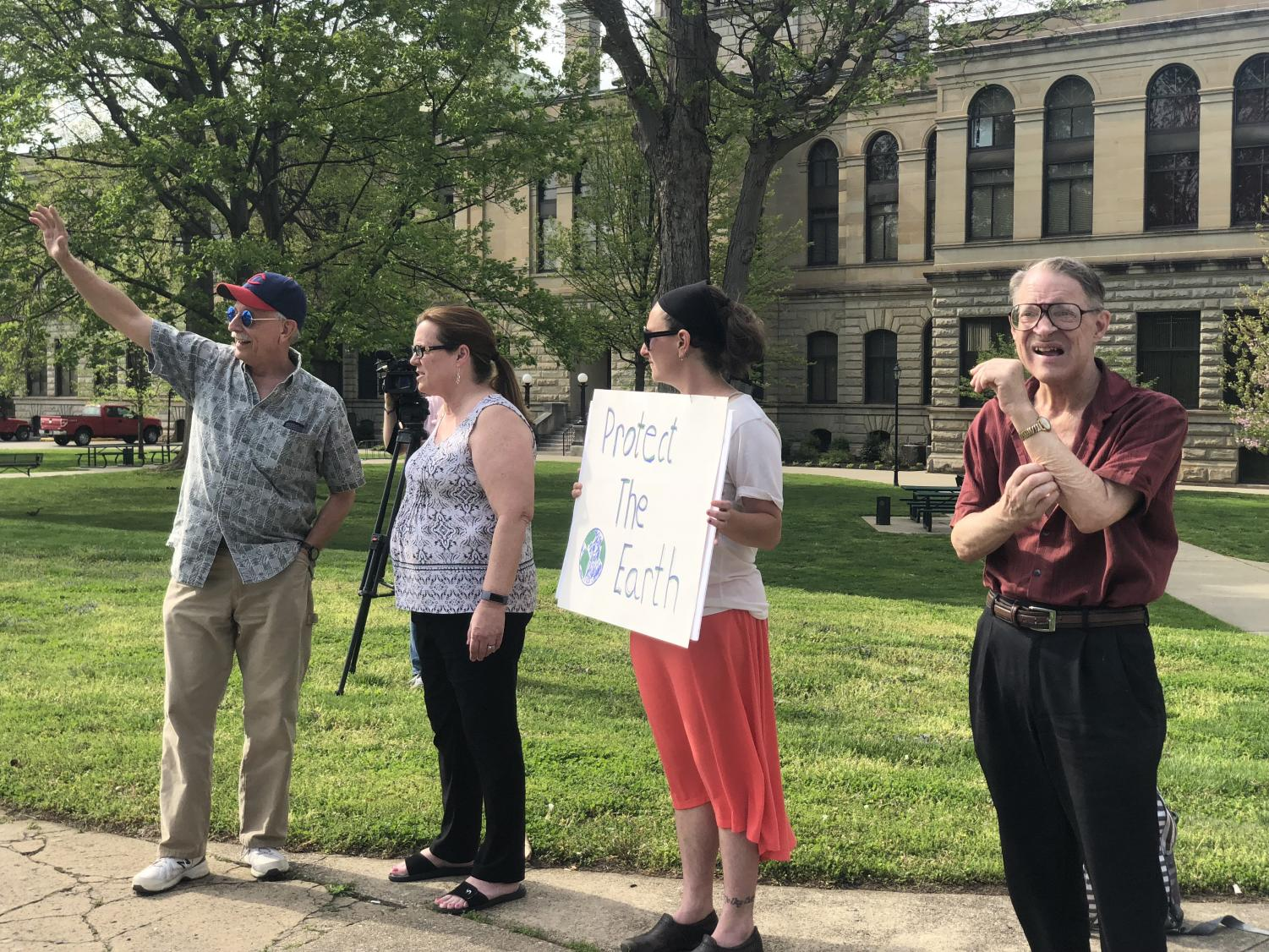 Protestors attempt to engage local passers by (left: Mark Connelly, left-center: Barbara Garnett, right: Charles Britz).