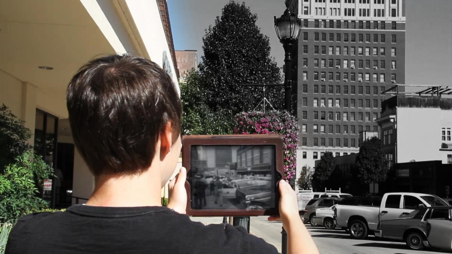 A student uses Clio in Huntington to view a historic protest on Fifth Avenue.