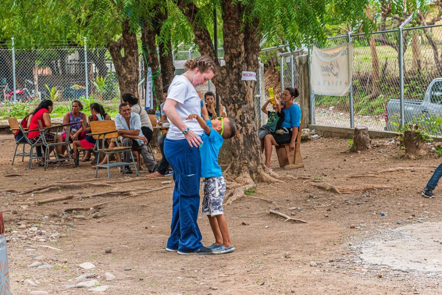 Student+embracing+young+Honduran+boy+after+a+visit+to+one+of+the+facilities++Marshall+students+had+set+up+for+their+trip.