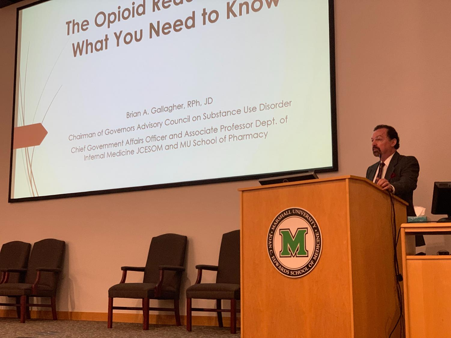 Dr. Brian A. Gallagher, chairman of the Governor's Advisory Council on Substance Use Disorder, addresses an auditorium of healthcare professionals at Cabell Huntington Hospital Aug. 28.