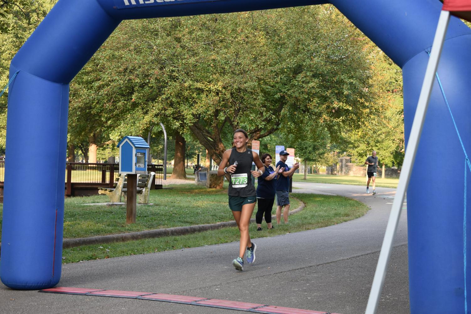 Local community member Alisha Harbour flashes a smile Saturday at Ritter Park just before completing Encouraging Every Step to Recovery 5k.