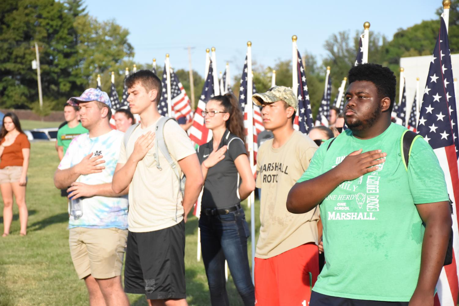 Marshall+students+stand+while+The+Star+Spangled+Banner+was+being+played.