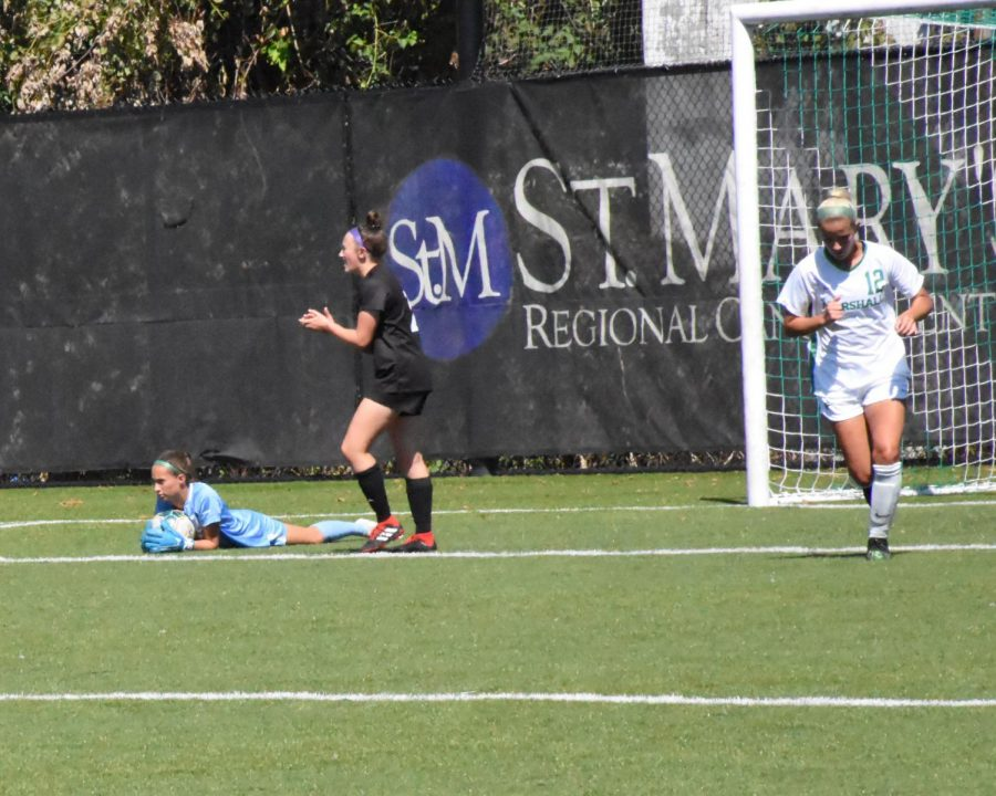 Lindsay Langley saves a goal during the Marshall vs High Point game.