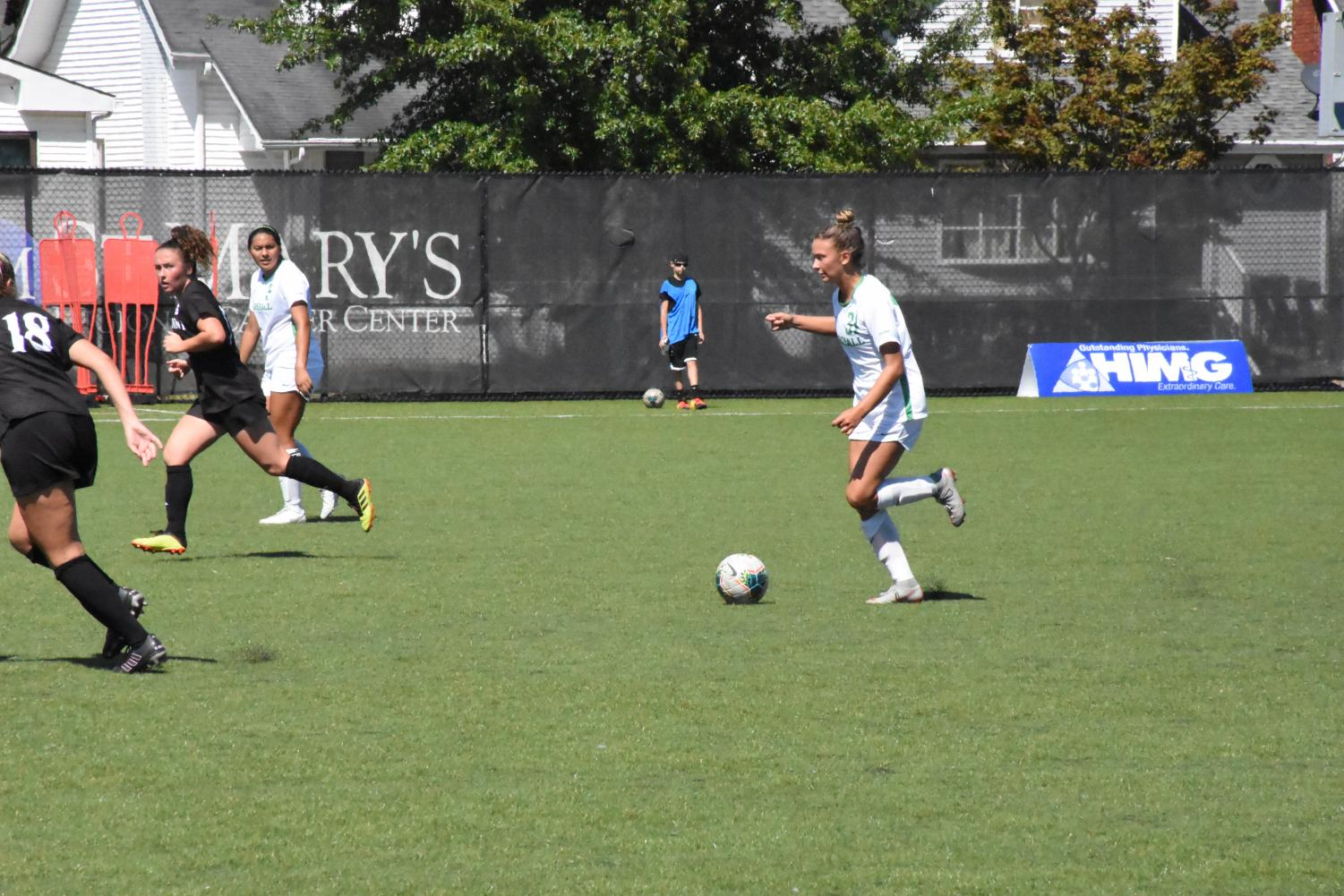 Molly Preston kicks the ball down the field for the Herd in its game against High Point on Sept. 15.