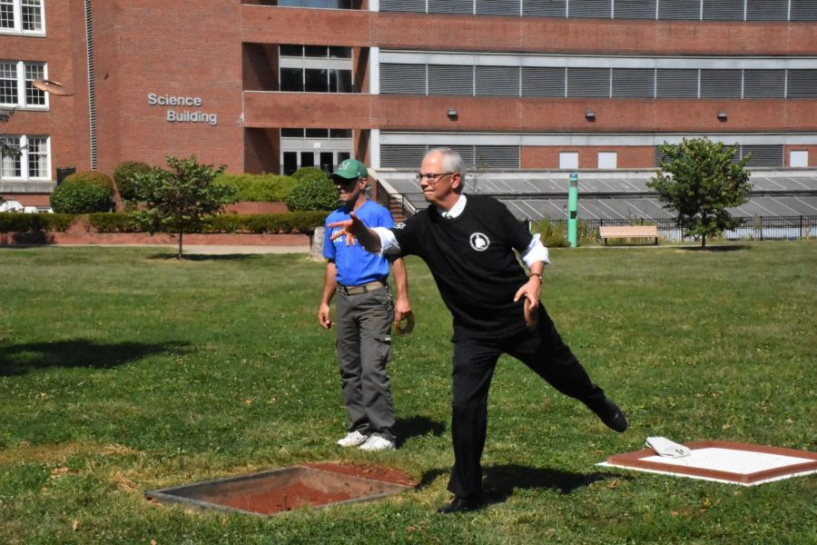 Marshall President Jerry Gilbert, on a team with Interim Vice President for Student Affairs and Associate Vice President of Intercultural Affairs Maurice Cooley, plays against an opponent on a team representing United Way of the River Cities.