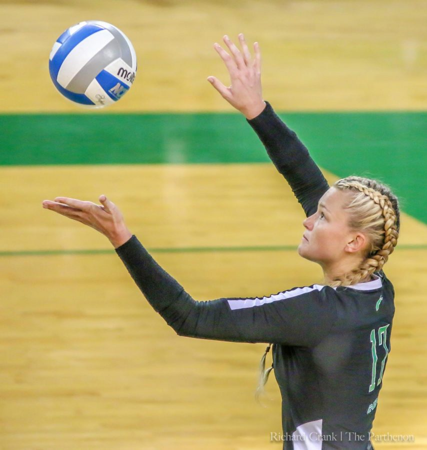 DeBell serves up the ball in the Green vs White game several weeks ago.