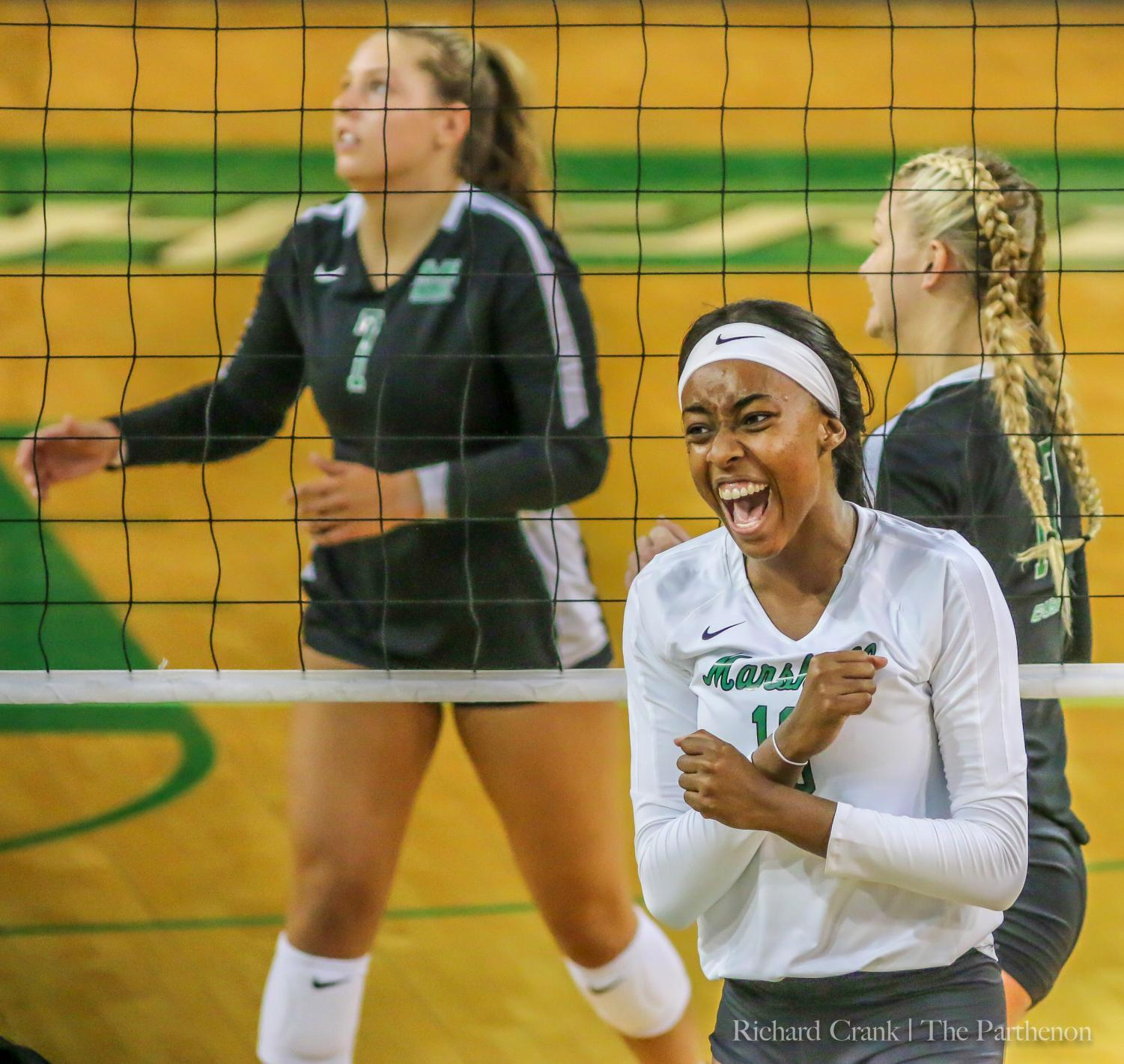 Destiny Leon celebrates a kill in the Green vs White volleyball match.