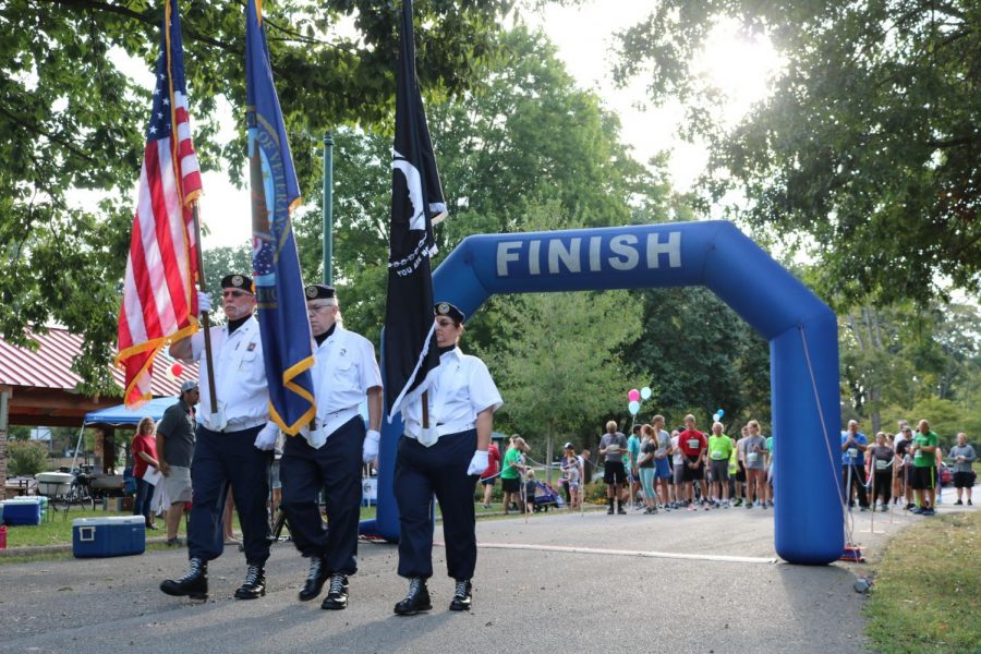 Veterans+present+the+flags+before+the+start+of+the+VA+Suicide+Awareness+and+Prevention+5k+race+held+in+Ritter+Park+Saturday+morning.