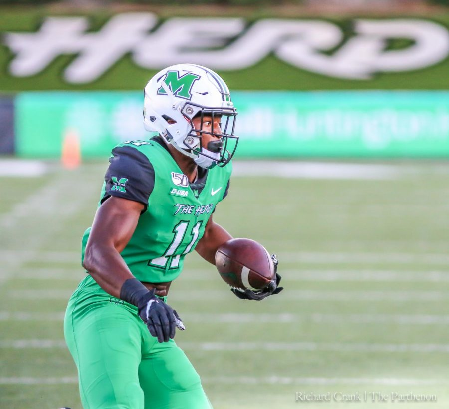 Xavier+Gaines+runs+the+ball+for+the+Herd+in+the+game+against+Ohio+on+Sept.+14.