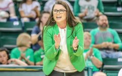Marshall volleyball coach Ari Agnus celebrates a job well done by her team.