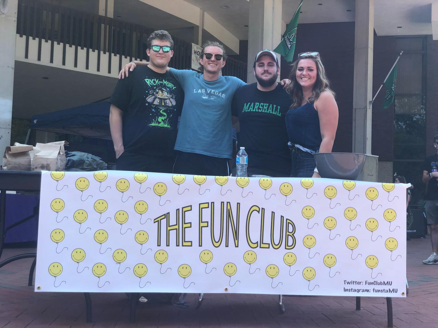 Marshall students Adam Bailey, Kane Morrone, Todd Turley and Madison Barker pose for a photo Wednesday, Sept. 11 at The Fun Club table during the university's Student Involvement & Organization Fair on the Memorial Student Center Plaza.
