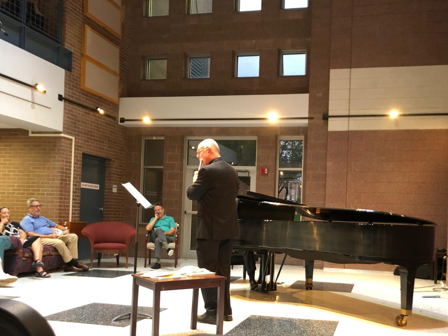 """Wendell Dobbs, professor of flute and flute theory, and Johan Botes, professor of piano and collaborative piano, perform during the """"About Bizet"""" recital Sept. 4."""