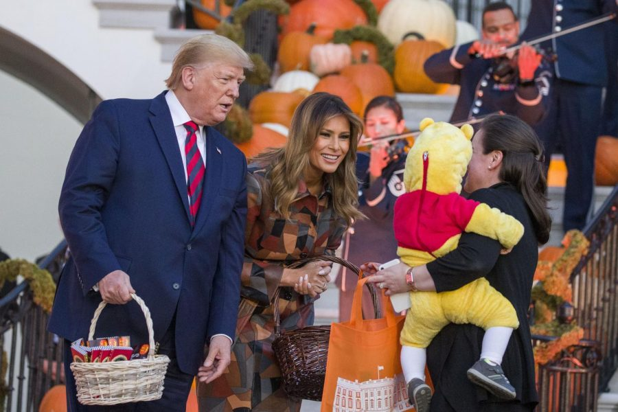 President+Donald+Trump+and+First+Lady+Melania+Trump+give+candy+to+children+during+a+Halloween+trick-or-treat+event+on+the+South+Lawn+of+the+White+House+which+is+decorated+for+Halloween%2C+Monday%2C+Oct.+28%2C+2019%2C+in+Washington.+