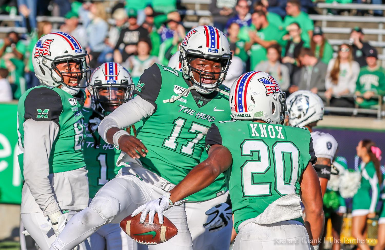 Marshall football player Isaiah Green is all smiles with teammate Brenden Knox in the game against Old Dominion.