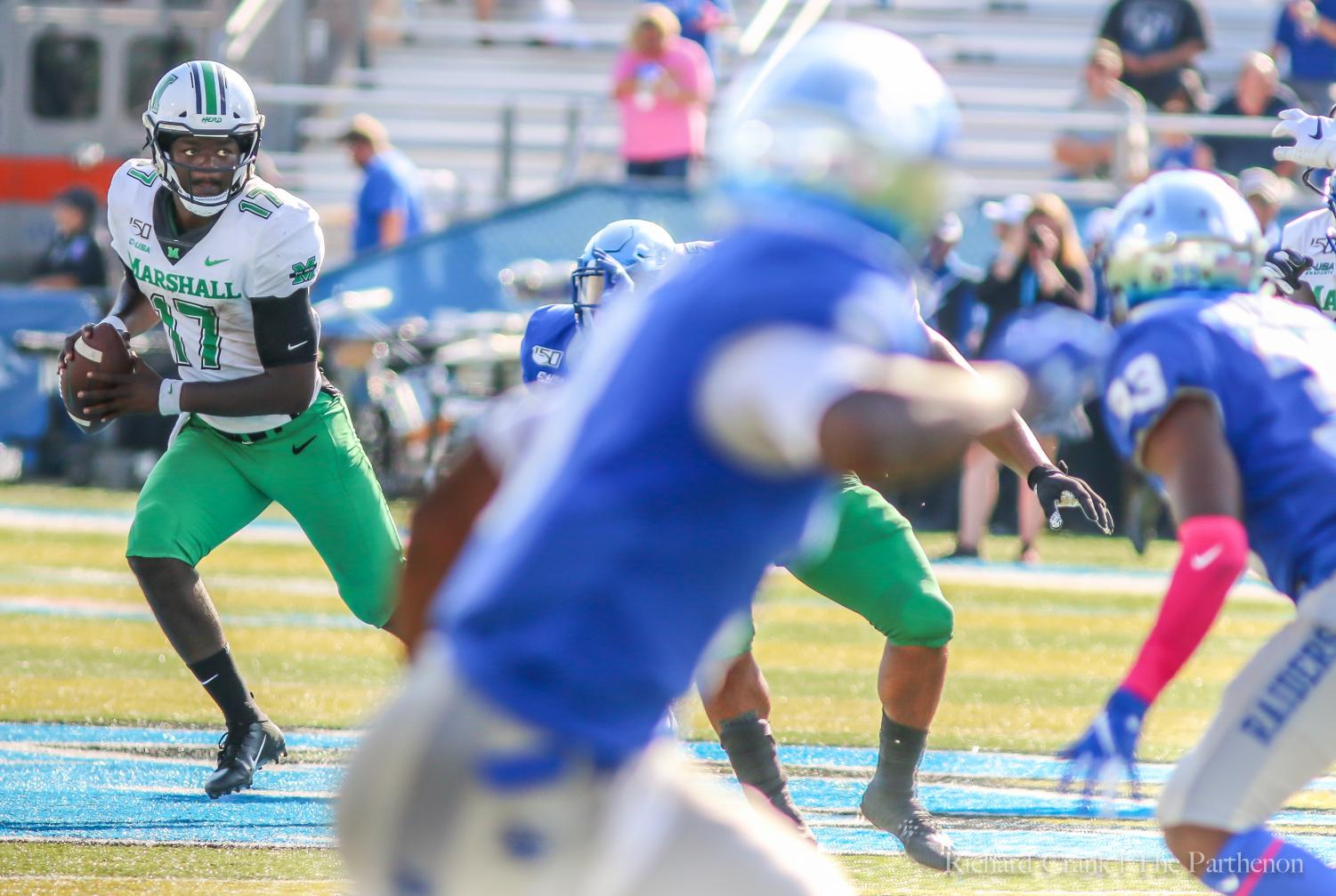 Herd quarterback Isaiah Green looks for an open receiver during Herd football game vs Middle Tennessee State University Oct. 5.