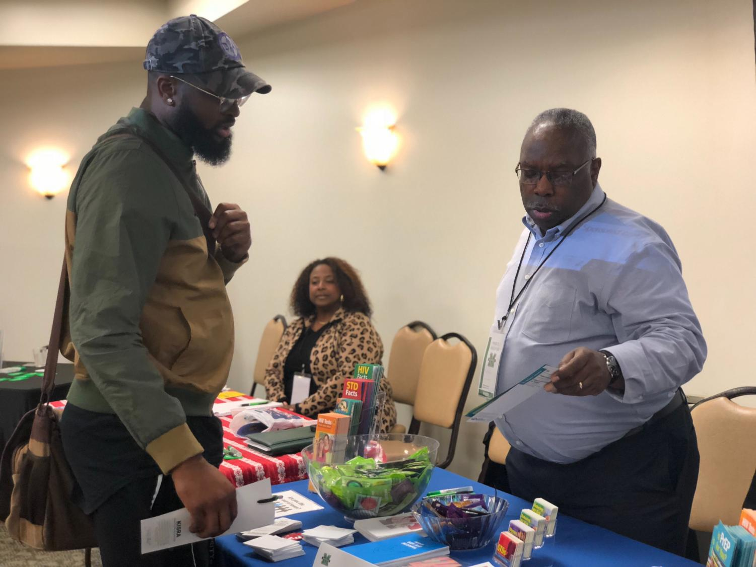 Marshall public health student Fortune Ezemobi interacts with Nils Haynes of the West Virginia Bureau for Public Health during the inaugural Minority Health Fair at the Memorial Student Center Oct. 17.