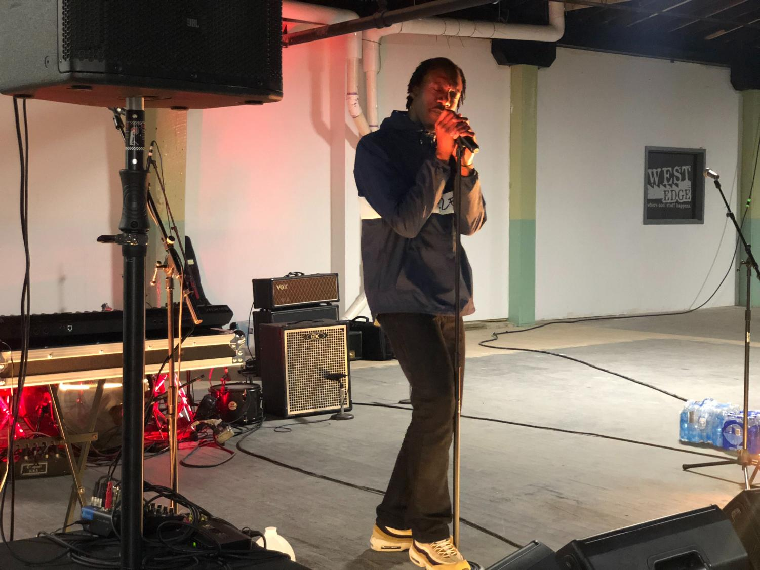 Local rapper Shelem performs during the Localization pop-up show at the West Edge Factory Oct. 18.