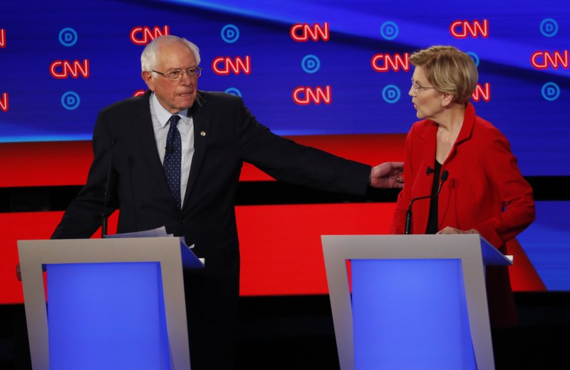 Sen.+Bernie+Sanders%2C+I-Vt.%2C+gestures+toward+Sen.+Elizabeth+Warren%2C+D-Mass.%2C+during+the+first+of+two+Democratic+presidential+primary+debates+hosted+by+CNN+Tuesday%2C+July+30%2C+2019%2C+in+the+Fox+Theatre+in+Detroit.+