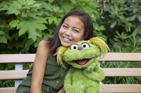 "Ten-year-old Salia Woodbury, whose parents are in recovery, with ""Sesame Street"" character Karli."