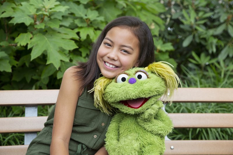 Ten-year-old+Salia+Woodbury%2C+whose+parents+are+in+recovery%2C+with+%E2%80%9CSesame+Street%E2%80%9D+character+Karli.+