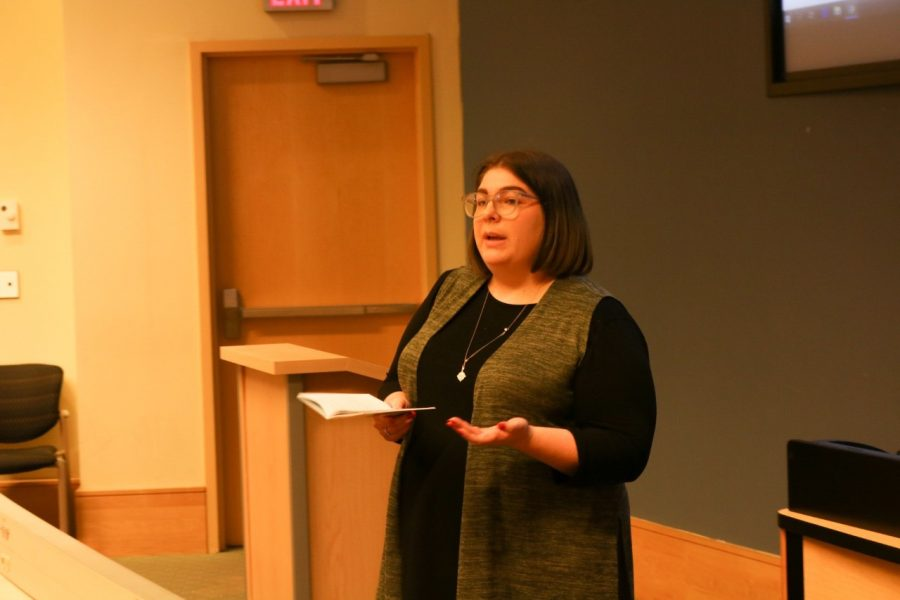 Katelyn Fowler, grant coordinator for MU-SPEAC, talks to students about suicide statistics in West Virginia.