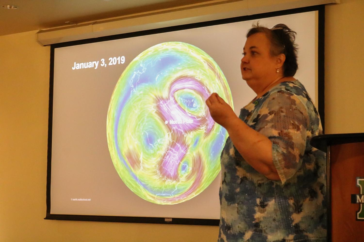 Kelli Larsen, professor of social work, addresses the crowd about the dangers of climate change during a presentation on Wednesday evening in the Memorial Student Center.