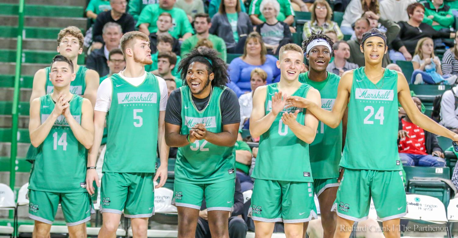 Herd teammates cheering each other on during Herd Madness.