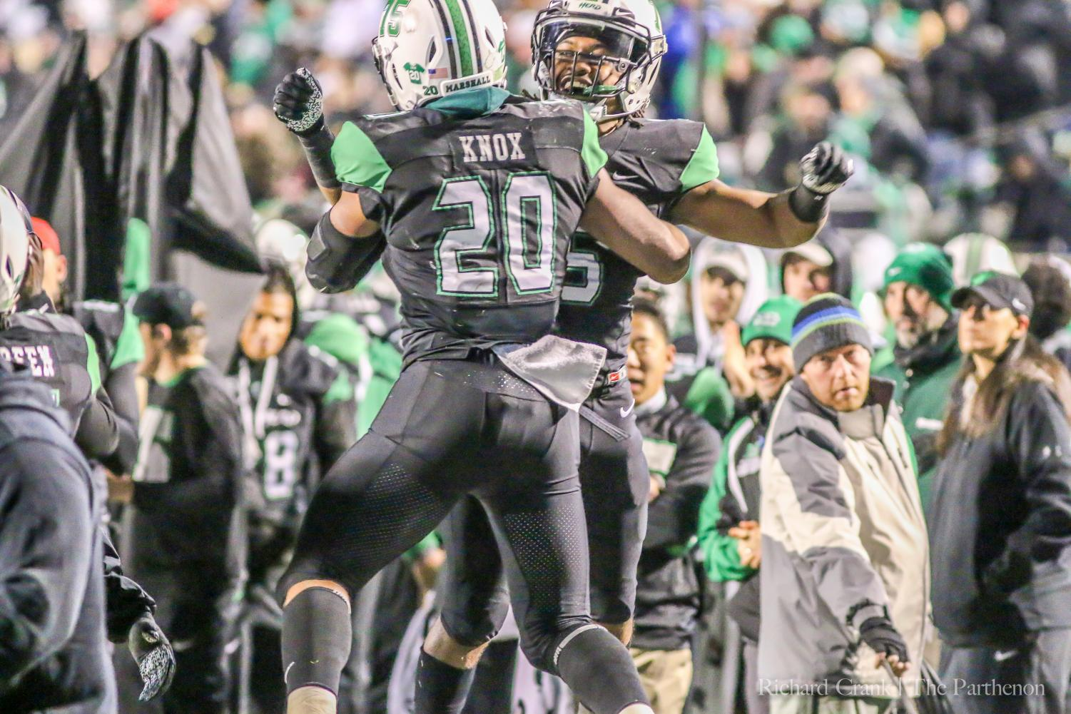 Brenden Knox and another football player celebrate after the touchdown in Saturday matchup against LA Tech.