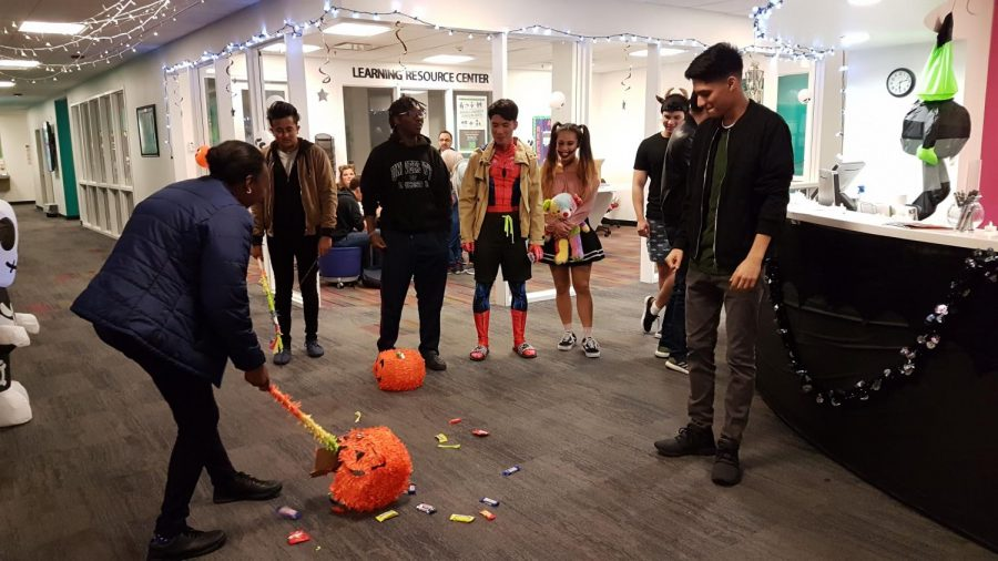 Both international and domestic Marshall students were given a Halloween experience including candy, pumpkins, costumes and free pizzas during the INTO Spooky Halloween Party Oct. 30.