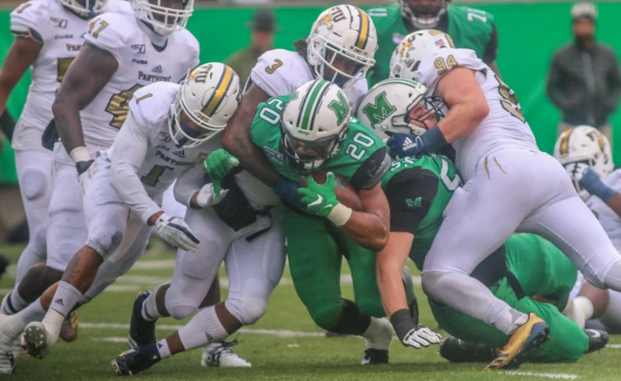 Brenden Knox carries the ball for the herd