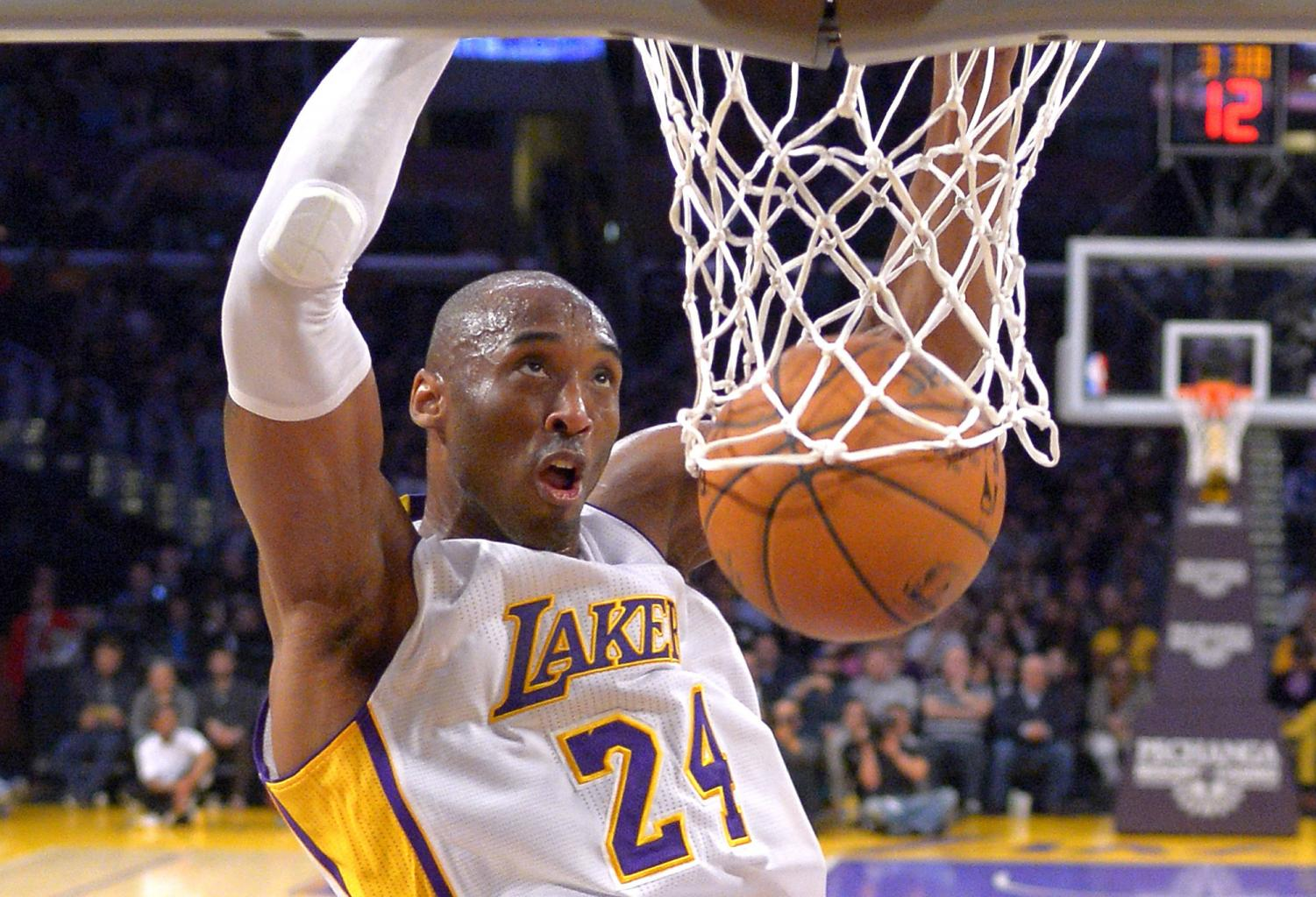 In this Jan. 4, 2015 file photo Los Angeles Lakers guard Kobe Bryant dunks during the first half of an NBA basketball game against the Indiana Pacers in Los Angeles. Bryant, a five-time NBA champion and a two-time Olympic gold medalist, died in a helicopter crash in California on Sunday, Jan. 26, 2020. He was 41.