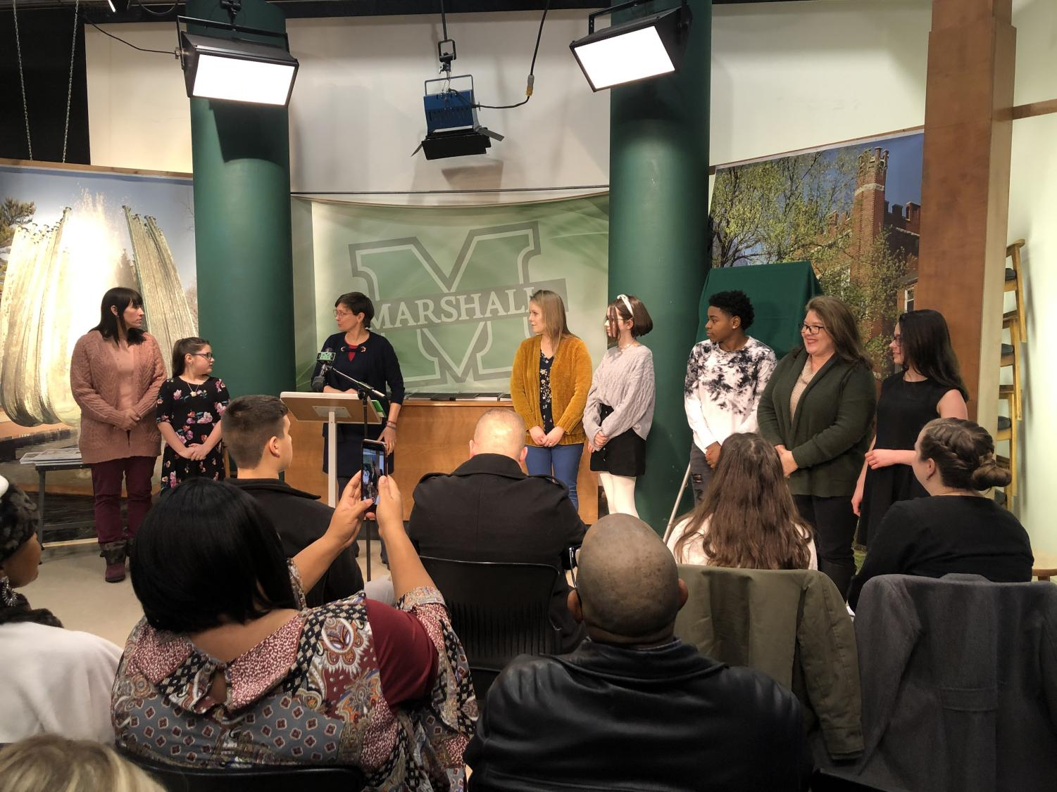Winners of the Black History Month poster contest receive recognition at the event on Tuesday, Jan. 21.