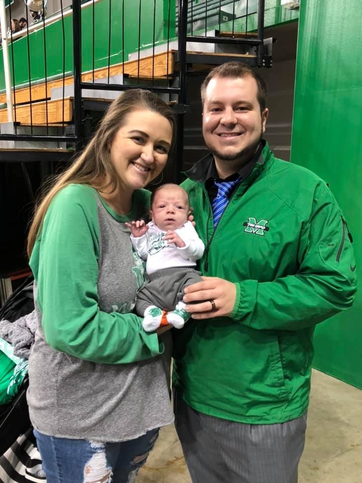 Neal and Haley Scaggs are supporting Herd men's basketball with their son, Scout.
