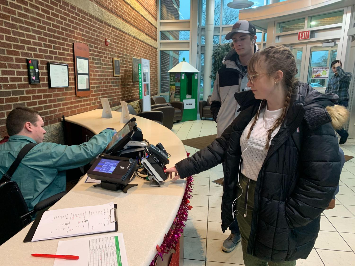 Marshall students using fingerprint technology as meal swipes at Harless Dining Hall.