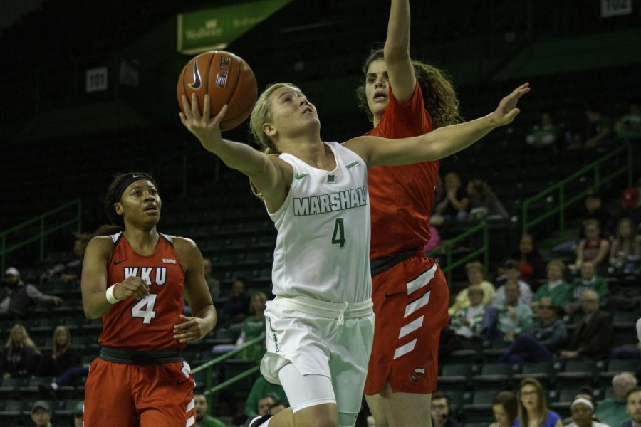 Freshman guard Savannah Wheeler drives to the basket against WKU's Raneem Elgedawy.