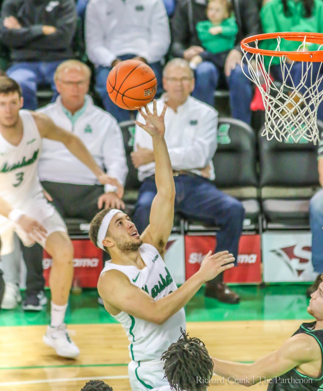 Junior guard Jarrod West floats the ball to the basket at the Cam Henderson Center.