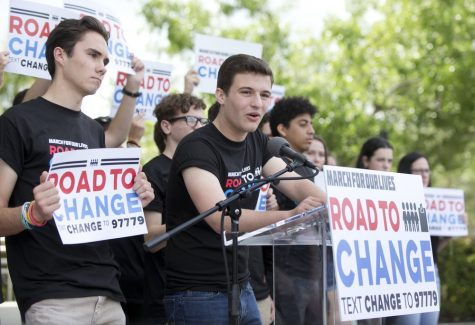 In this June 4, 2018 photo, Cameron Kasky, center, speaks during a news confrence in Parkland, Fla., announcing a multistate bus tour to get young people educated, registered and motivated to vote.