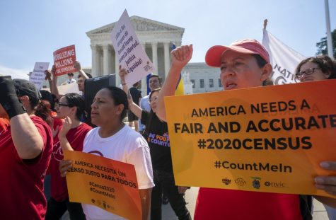 In this June 2019 photo, demonstrators gather at the Supreme Court on Capitol Hill as justices finish the term with key decisions on gerrymandering and a census case involving the Trump administration's attempt to ask about citizenship status in the 2020 census.