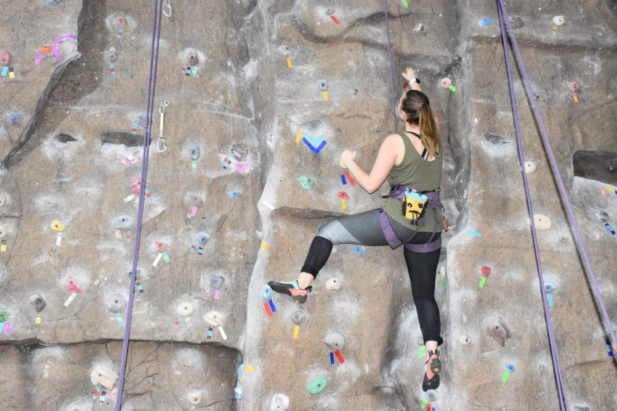 Marshall graduate, Vivian Hodges, using the rock wall located at the Rec Center. The rock wall is free for students and members to use