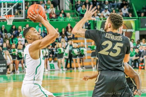 Taevion Kinsey lined up his shot during a home game at the Cam Henderson Center.