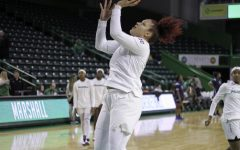 Junior forward Taylor Pearson attempted a layup during game day warmups.