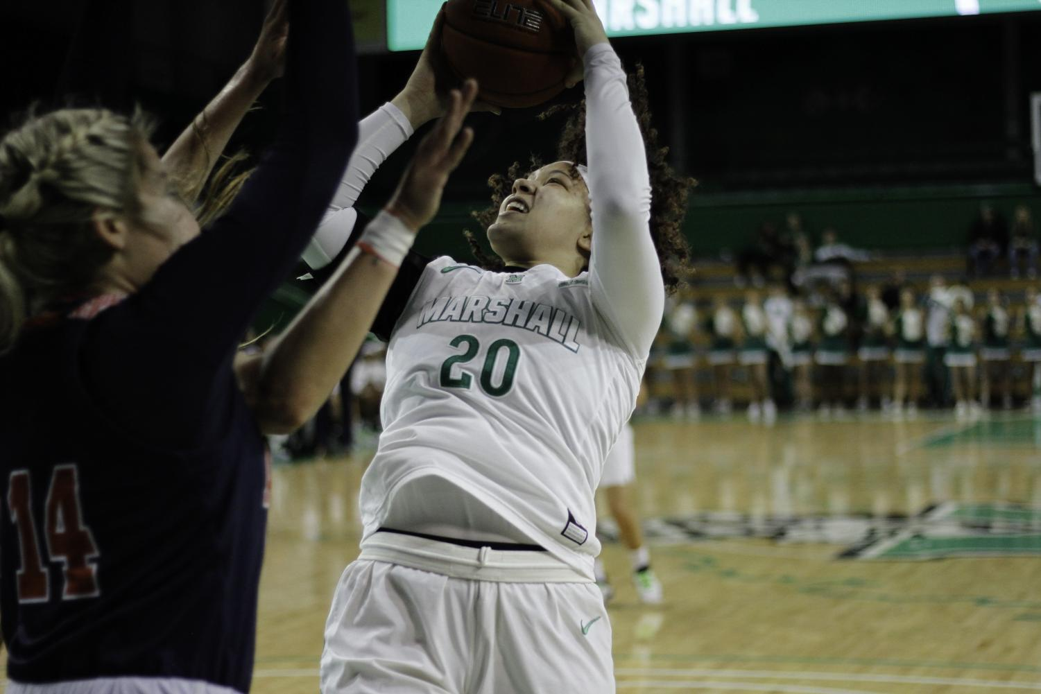 Junior Taylor Pearson put up a basket at the Cam Henderson Center.