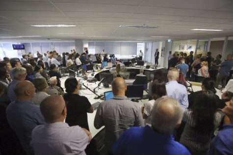 Staff at the Australian Associated Press head office gather for an announcement in Sydney, March 3, 2020.