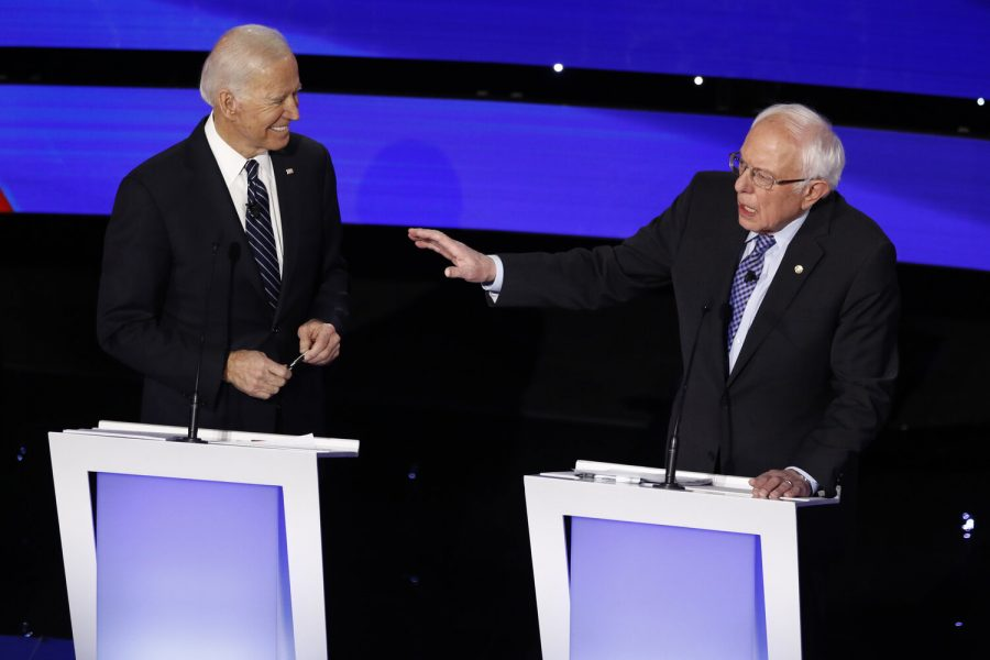 Democratic+presidential+candidate+Sen.+Bernie+Sanders%2C+I-Vt.%2C+speaks+as+former+Vice+President+Joe+Biden+looks+on+Tuesday%2C+Jan.+14%2C+2020%2C+during+a+Democratic+presidential+primary+debate+hosted+by+CNN+and+the+Des+Moines+Register+in+Des+Moines%2C+Iowa.+%28AP+Photo%2FPatrick+Semansky%29