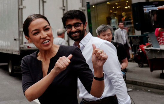 Alexandria Ocasio-Cortez, the winner of a Democratic Congressional primary in New York, greets a passerby in New York, Wednesday, June 27, 2018, the morning after she upset U.S. Rep. Joe Crowley in Tuesday's primary election. (AP Photo/Mark Lennihan)