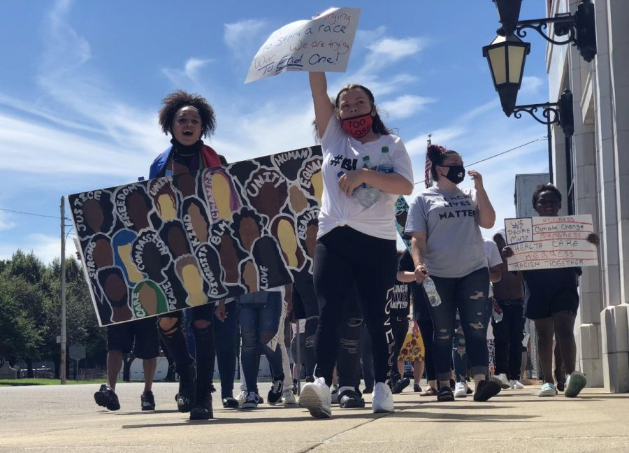 Locals march to protest police brutality, racism