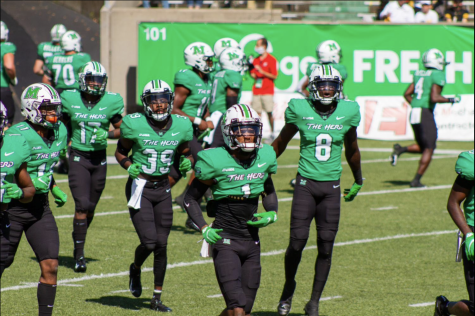 The Marshall University football team runs out onto the field before the Appalachain State game.